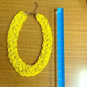 Yellow braided beaded necklace